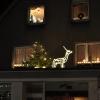 Rentier mit Weihnachtsbaum